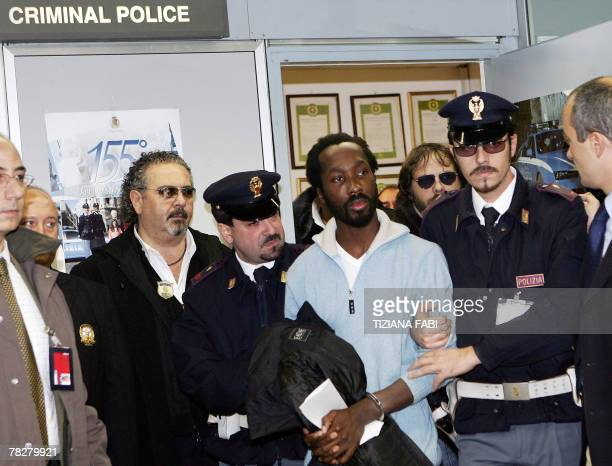 Ivory Coast citizen Rudy Hermann Guede arrives at Rome's Fiumicino airport 06 December 2007 after being extradited from Germany where he was arrested...
