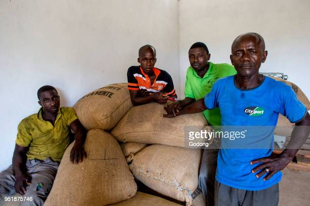 Ivory Coast Cocoa cooperative members in a warehouse
