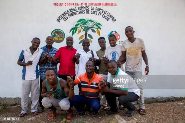 Ivory Coast Cocoa cooperative outside a warehouse