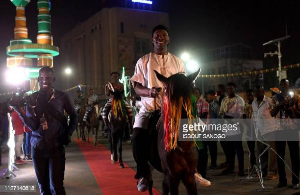 Ivory Coast comedian and actor Isaac de Bankole arrives on horseback during FESPACO, Panafrican Film and Television Festival of Ouagadougou on...