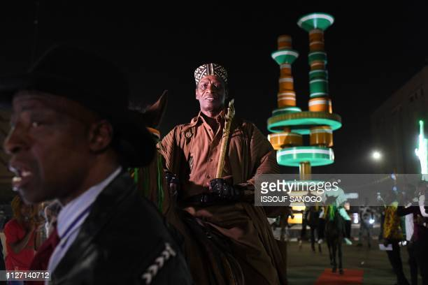 Ivory Coast comedian and actor Siriki Bakaba arrives on horseback during FESPACO, Panafrican Film and Television Festival of Ouagadougou on Febuary...