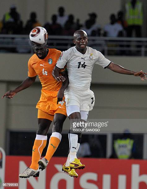 Ivory Coast defender Habib Kolo Toure vies for the ball with Ghana's Asamoah Mathew during their group stage match at the Chiazi stadium in Cabinda...