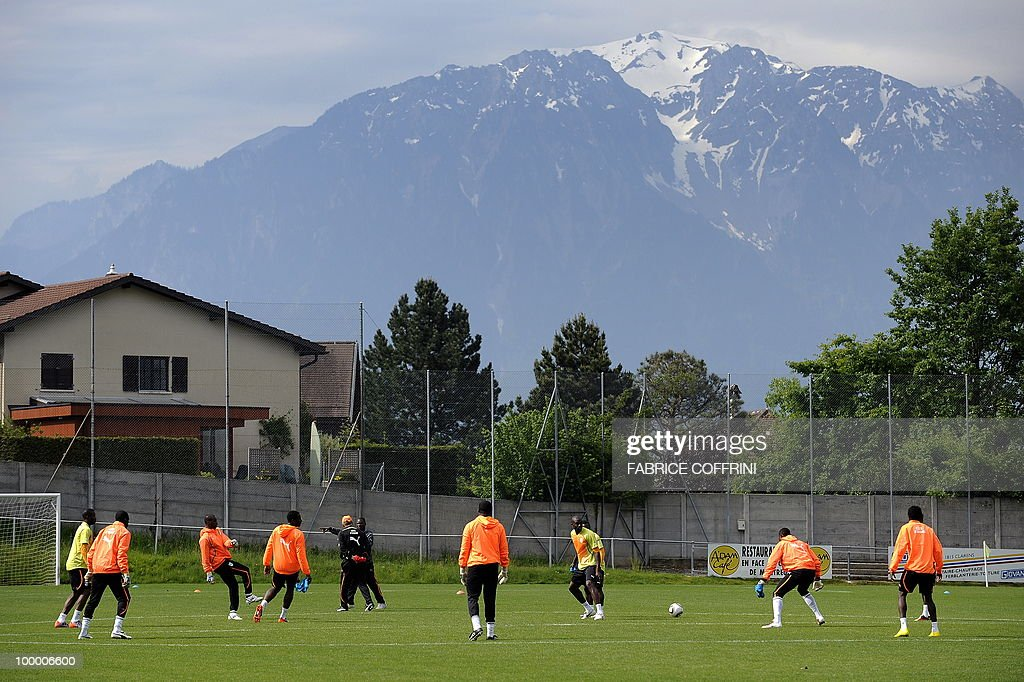 Ivory Coast football players warm-up during a practice session with the Alps on background on May 20, 2010 in Montreux ahead of the FIFA World Cup 2010 finals in South Africa. A high-profile casualty is inevitable in Group G at the World Cup with Brazil, Portugal and Ivory Coast fighting for two places while North Korea concentrate on damage limitation.