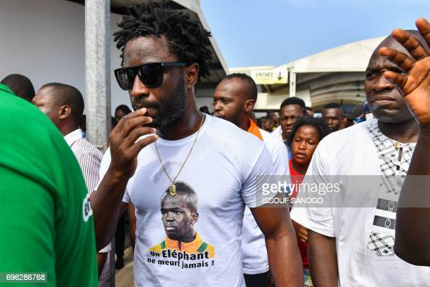 Ivory Coast forward Wilfried Bony attends the arrival of the casket of the late Ivory Coast midfielder Cheick Tiote on June 15 2017 upon its arrival...