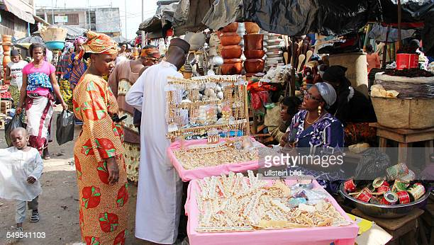 In the Market Hall of Abidjan cooperative project of COCOVICO street scene with people shopping