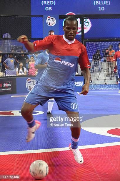 Ivory Coast national football team captain and former Chelsea player Didier Drogba in action during an exhibition indoor football match at the Pepsi...