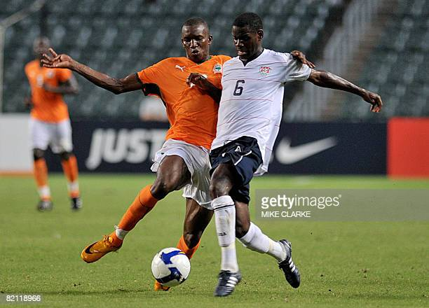 Ivory Coast player Sekou Cisse fight for the ball with Maurice Edu of the US during a warm up tournament ahead of the Beijing Olympic Games in Hong...