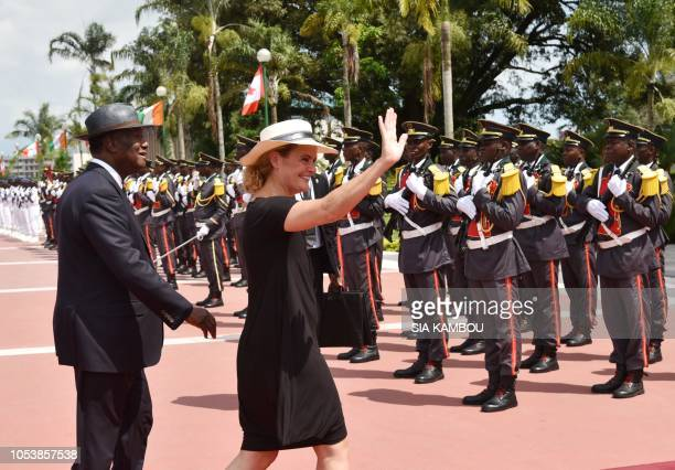 Ivory Coast president Alassane Ouattara and Canada Governor General Julie Payette walk upon her arrival at the Presidential Palace in Abidjan on...