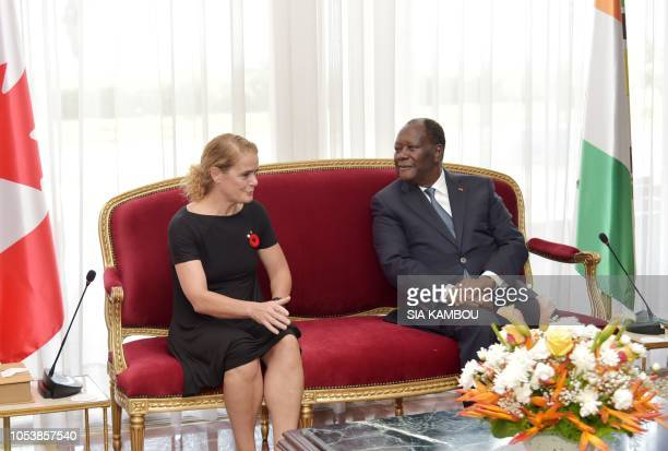 Ivory Coast president Alassane Ouattara and Canada Governor General Julie Payette talk upon her arrival at the Presidential Palace in Abidjan on...