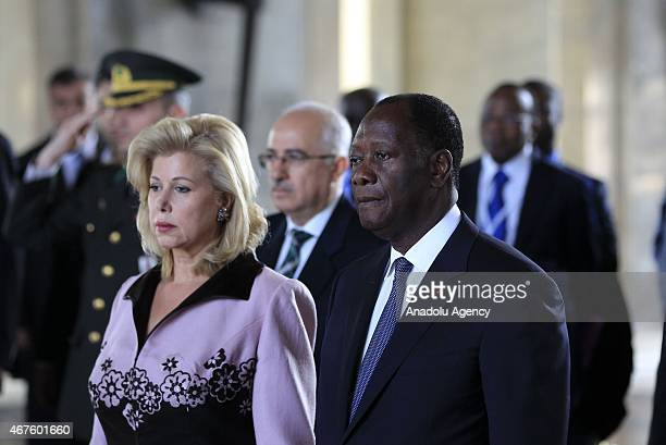 Ivory Coast President Alassane Ouattara and his wife Dominique Ouattara stand in silence during their visit Anitkabir the mausoleum of founder and...