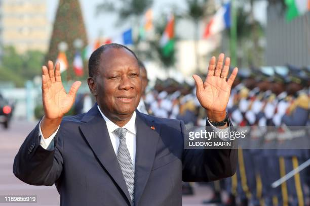 Ivory Coast President Alassane Ouattara arrives at the Presidential Palace to meet with his French counterpart in Abidjan, as part of a three day...