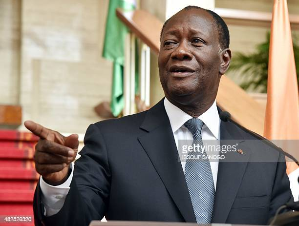 Ivory Coast president Alassane Ouattara gestures during a joint press conference with Burkina Faso's transitional president after their meeting at...