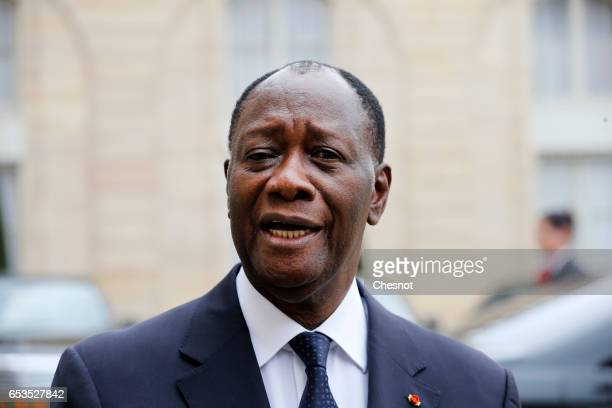 Ivory Coast president Alassane Ouattara makes a statement after his meeting with French President Francois Hollande at the Elysee Presidential Palace...