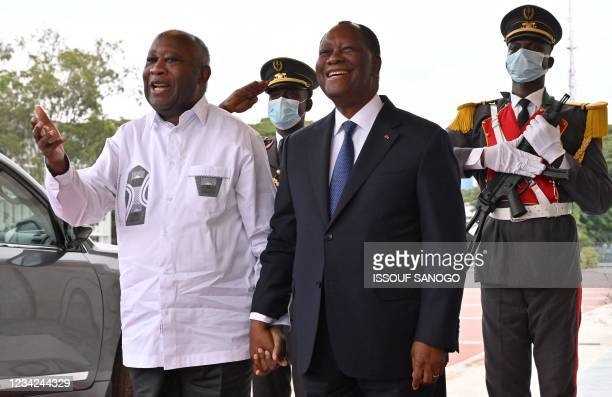 Ivory Coast President Alassane Ouattara poses with former President Laurent Gbagbo at the presidential palace in Abidjan, on July 27, 2021. - Ivory...