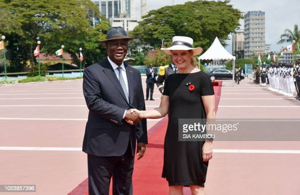 Ivory Coast president Alassane Ouattara shakes hands with Canada Governor General Julie Payette upon her arrival at the Presidential Palace in...