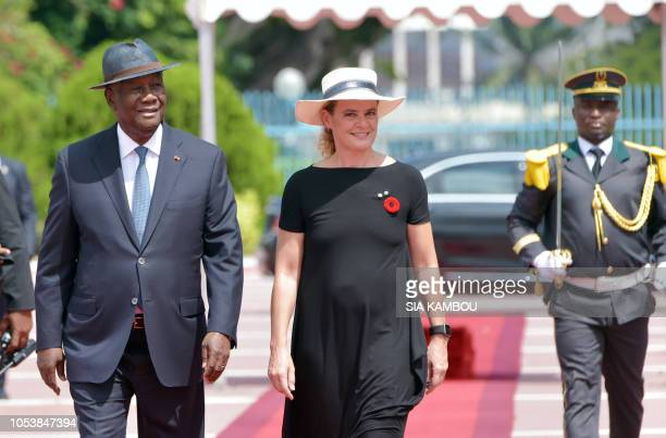 Ivory Coast president Alassane Ouattara walks with Canada Governor General Julie Payette during a welcome ceremony at the Presidential Palace in...