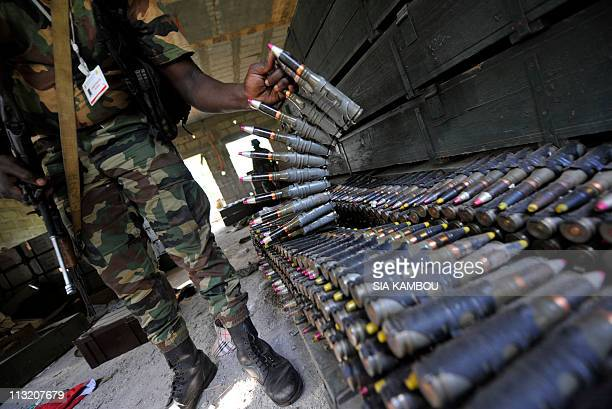 Ivory Coast President Alassane Ouattara's Republican Forces collect weapons and ammunitions left by former strongman Laurent Gbagbo's Defense and...