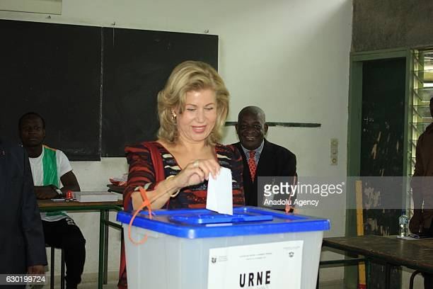 Ivory Coast President Alassane Ouattara's wife Dominique Folloroux-Ouattara casts her vote during the parliamentary elections in Abidjan, Ivory Coast...