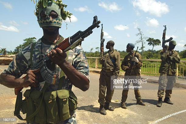 Ivory Coast rebels man the Baoulifla checkpoint October 21, 2002 in Baouke, Ivory Coast. French troops have been deployed to maintain a buffer zone...