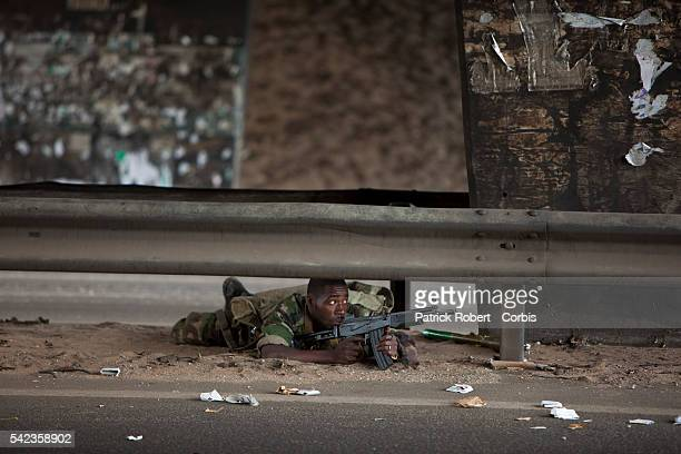 Ivory Coast Republican Force fighters loyal to Presidentelect Alassane Ouattara are seen in the neighborhood of Yopougon in favor of Laurent Gbagbo