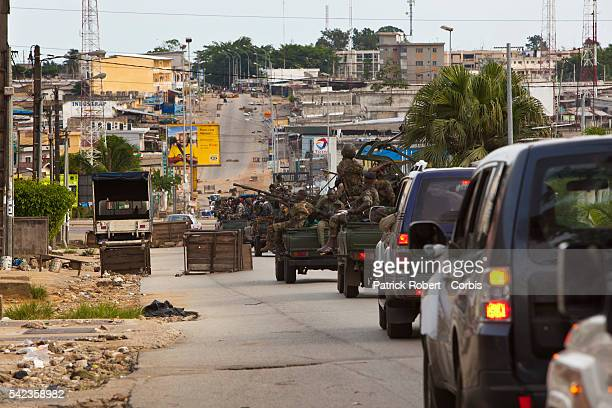 Ivory Coast Republican Force fighters loyal to Presidentelect Alassane Ouattara on patrol in the streets of Abidjan to contain the lootings and the...