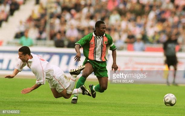 Ivory Coast 's captain Guel Tarissoua dribles past Tunisian Meher Kanzari as part of the qualifying in the World Cup Africa zone Group D match...