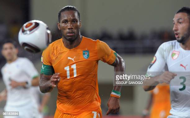 Ivory Coast striker and team captain Didier Drogba chases the ball on January 24 2010 at the Chiazi stadium in Cabinda during their quarter final...