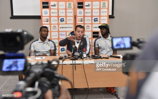Ivory Coast team's Belgian coach Marc Wilmots flanked by players Salomon Kalou and Ivorian player Gervais Yao Kouassi aka Gervinho speaks during a...