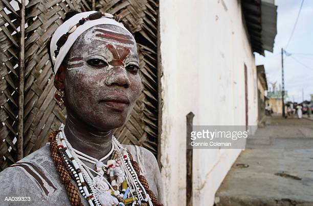 ivory coast, woman wearing face paint, portrait - african tribal face painting stock photos and pictures
