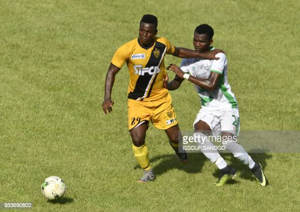 Ivory Coast's Amed Toure vies with Zambia's Lameck Banda during the Confederation of African Football Champions League match between Asec d'Abidjan...