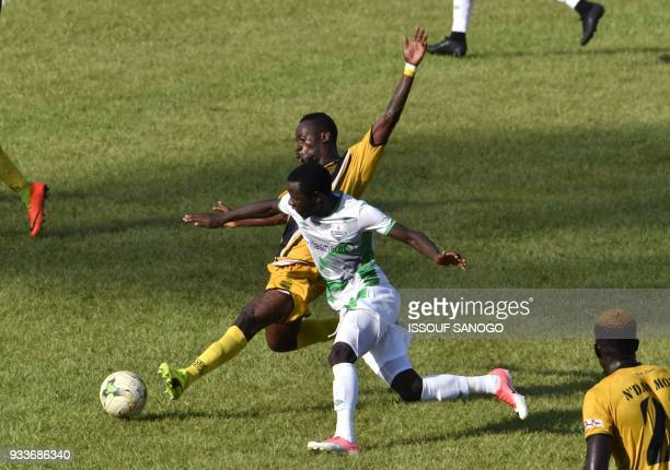 Ivory Coast's Anicet Badie Gbagnon vies with Zambia's Lazzrous Kambole during the Confederation of African Football Champions League match between...