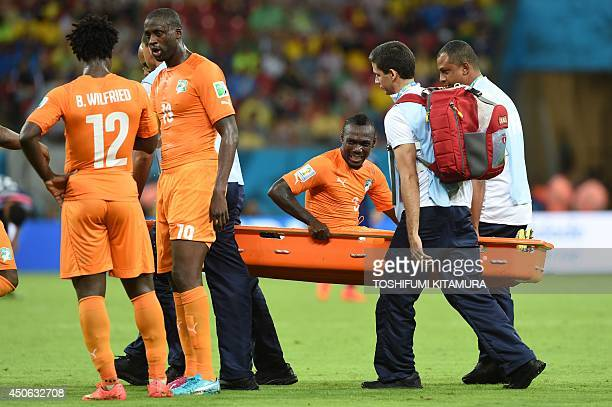 Ivory Coast's defender Arthur Boka is stretched out during a Group C football match between Ivory Coast and Japan at the Pernambuco Arena in Recife...