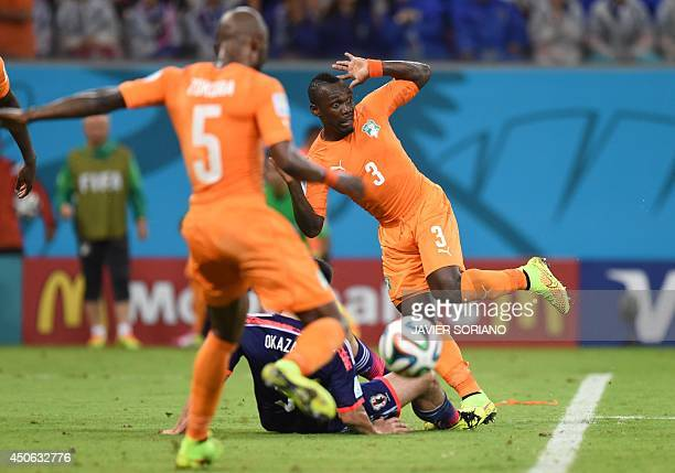 Ivory Coast's defender Arthur Boka is tackled by Japan's forward Shinji Okazaki during a Group C football match between Ivory Coast and Japan at the...