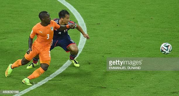 Ivory Coast's defender Arthur Boka vies with Japan's forward Shinji Okazaki during a Group C football match between Ivory Coast and Japan at the...