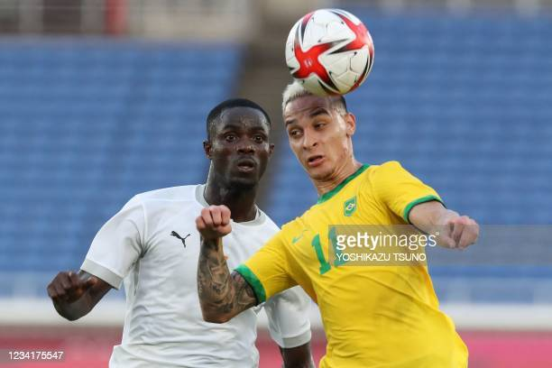 Ivory Coast's defender Eric Bailly fights for the ball with Brazil's forward Antony during the Tokyo 2020 Olympic Games men's group D first round...