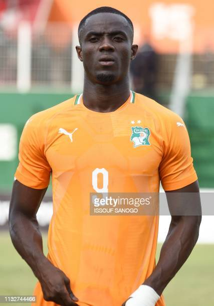 Ivory Coast's defender Eric Bailly poses at the Felix HouphouetBoigny stadium in Abidjan on March 23 2019