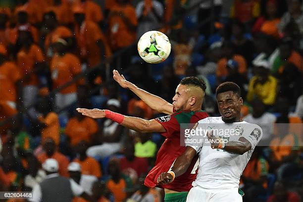 TOPSHOT Ivory Coast's defender Serge Aurier heads the ball with Morocco's forward Youssef EnNesyri during the 2017 Africa Cup of Nations group C...