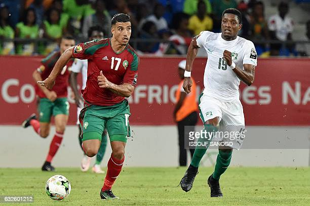 Ivory Coast's defender Simon Deli challenges Morocco's midfielder Nabil Dirar during the 2017 Africa Cup of Nations group C football match between...
