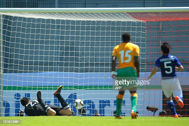 Ivory Coast's Didier Drogba scores from a free kick to make it 10 against Japan during a friendly international football match at the Tourbillon...