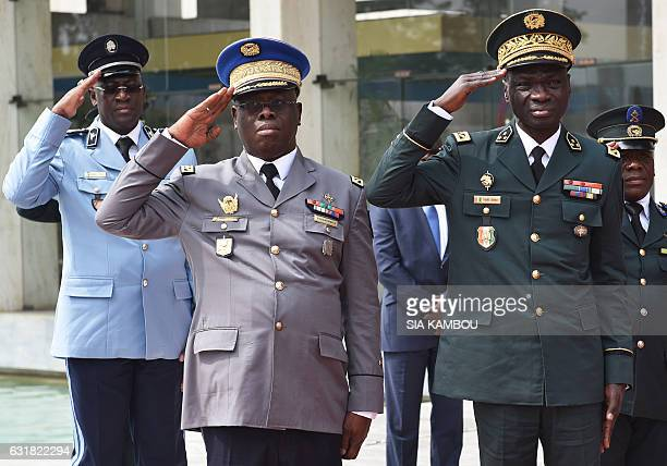 Ivory Coast's directorgeneral of the police Youssouf Kouyate senior commander of the national gendarmerie Nicolas Kouadio Kouakou and newly appointed...