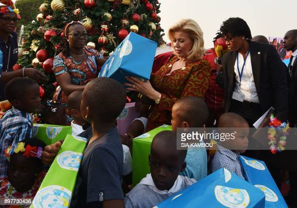 Ivory Coast's First Lady Dominique Ouattara distributes gifts to children at the presidential palace in Abidjan on December 23 during a Christmas...