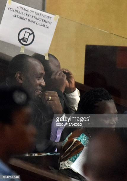 Ivory Coast's former first lady Simone Gbagbo sits in the Court of Justice in Abidjan on Fevuary 23 2015 for her trial along with others for...