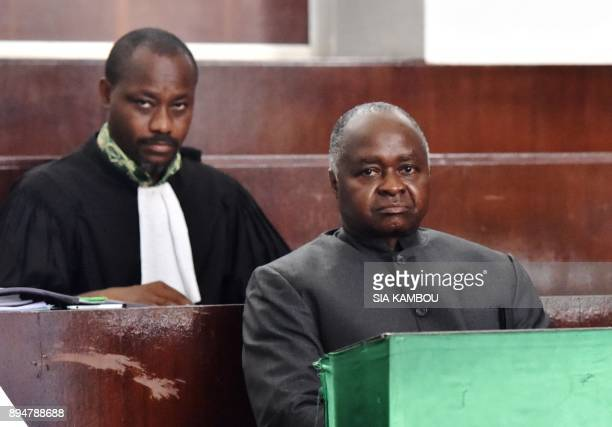 Ivory Coast's former Minister of public function and employment Hubert Oulaye looks on during his trial at the Abidjan Tribunal on December 18 2017...
