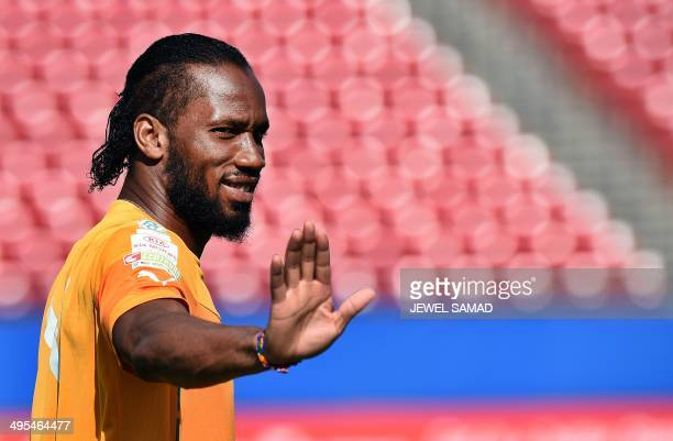 Ivory Coast's forward Didier Drogba arrives for a training session at the Toyota Stadium in Frisco Texas on June 3 on the eve of their World Cup...