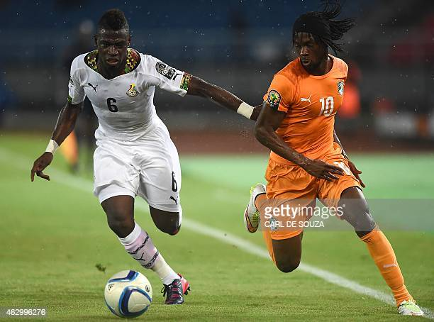 Ivory Coast's forward Gervinho challenges Ghana's midfielder Afriyie Acquah during the 2015 African Cup of Nations final football match between Ivory...