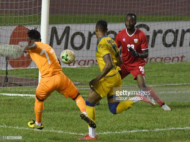 Ivory Coast's forward Jonathan Kodj scores a goal against Rwanda's goalkeeper Yves Kimenyi during the 2019 African Cup of Nations Group H...