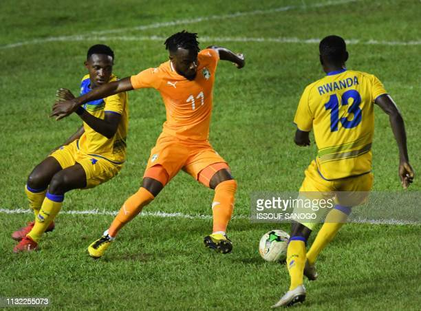 Ivory Coast's forward Jonathan Kodj vies for the ball with Rwanda's Fitina Omborenga during the 2019 African Cup of Nations Group H qualification...