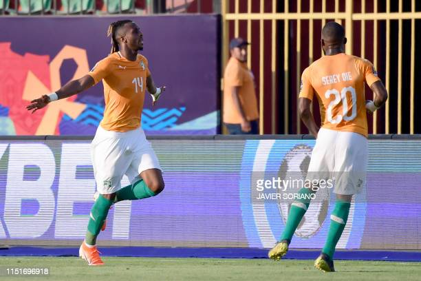 Ivory Coast's forward Jonathan Kodjia celebrates after scoring a goal during the 2019 Africa Cup of Nations football match between Ivory Coast and...