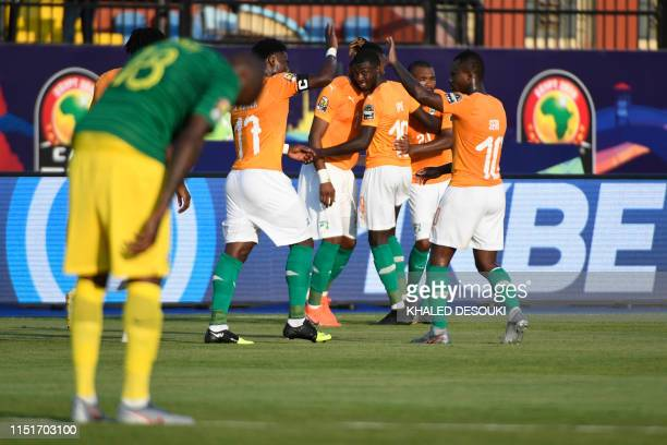 Ivory Coast's forward Jonathan Kodjia celebrates with his team after winning the 2019 Africa Cup of Nations football match between Ivory Coast and...