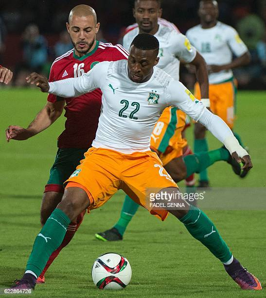 Ivory Coast's forward Jonathan Kodjia is marked by Morocco's forward Nordin Amrabat during the World Cup 2018 qualifier football match between...